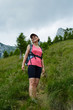 Woman hiker on a steep trail