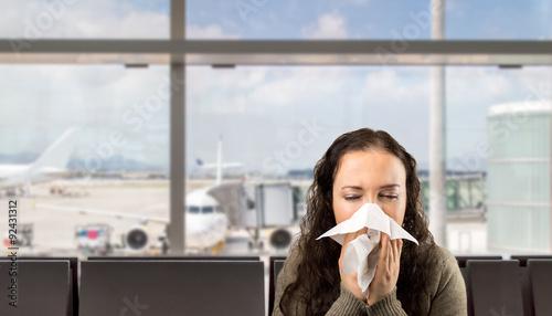 Carta da parati sick woman sneezing at the  airport