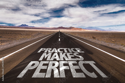 Fotomural  Practice Makes Perfect written on desert road
