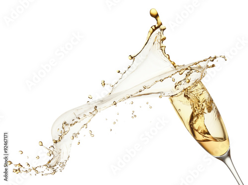 Foto  champagne splash from glass isolated on the white background