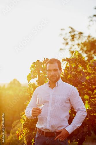 Fototapeta Man with a glass of white wine obraz na płótnie