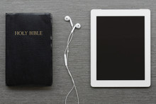 Contemporary Image Of The Bible And Tablet.
