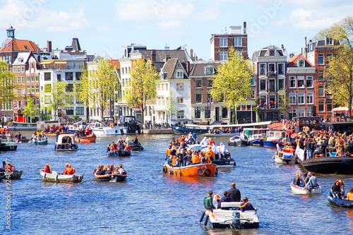 Photo Stands Amsterdam AMSTERDAM - APR 27: People celebrating Kings Day in Amsterdam on