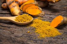 Turmeric Powder In Spoon And R...