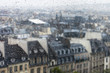 PARIS, FRANCE, on SEPTEMBER 27, 2015. A view of the city from a window from a high point during a rain. Rain drops on glass. Focus on drops