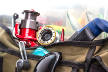 Fishing Tackles And Lures In Open Handbag