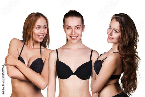 Foto  Three beautiful sexy women showing their black bra