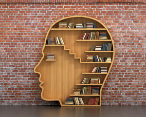 Concept of training. Wooden bookshelf full of books in form of m