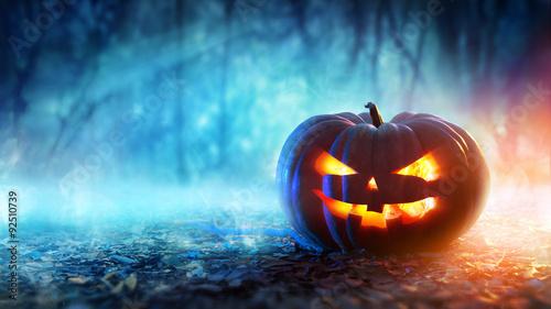 Fotografie, Obraz  Halloween Pumpkin In A Mystic Forest At Night