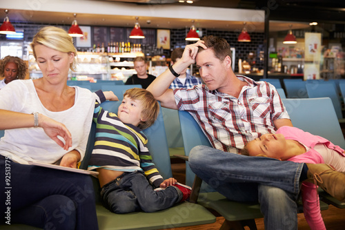Fotografie, Obraz  Family In Airport Departure Lounge Wait For Delayed Flight