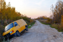 Van Drove Into The Ditch. Yellow Minibus Crashed On A Deserted Dirt Road