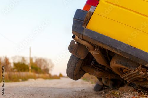 Fotografie, Obraz  car wheels got stuck in a ditch