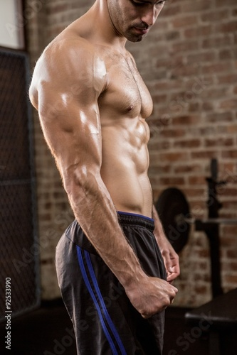 Fototapeta Midsection of a shirtless man showing his body obraz na płótnie