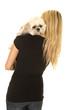 woman black shirt with dog over shoulder look sad