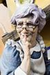 Ninot fallero señora con gafas