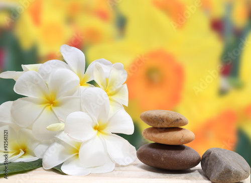 Photo  Zen spa concept background - Zen massage stones with frangipani plumeria flower