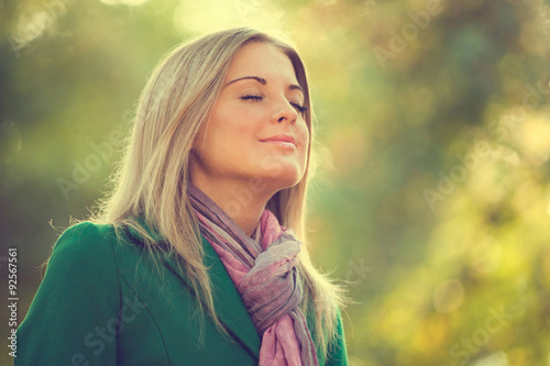 Fotomural  Young woman enjoying fresh air in autumn, intentionally toned.