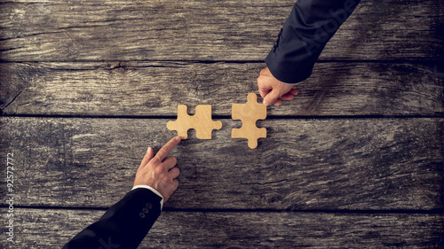 Canvas-taulu Retro style image of two business partners each placing one matc