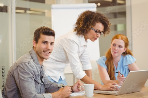 Fototapety, obrazy: Businessman with female colleagues in meeting