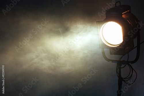 Aluminium Prints Light, shadow theater spot light with smoke against grunge wall