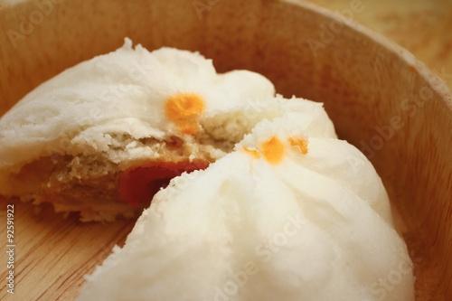 steamed dumpling - chinese bun on brown background. #92591922