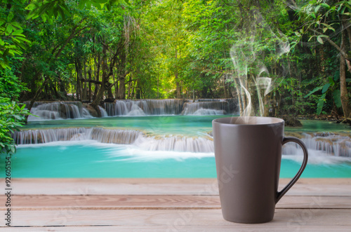 Recess Fitting Cafe coffee cup with smoke on waterfall background