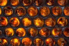 The Wall Of Glass Bottles Bottoms Folded Forward. Background. Se