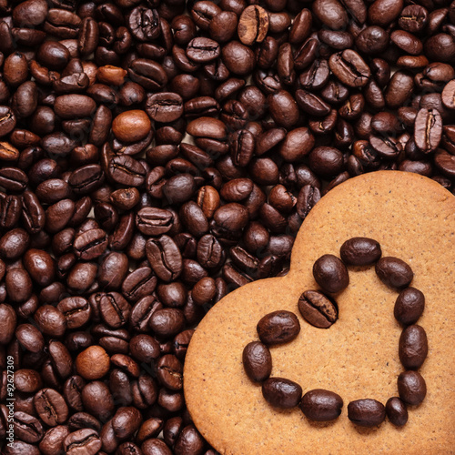 Fényképezés  Heart shaped cookie on coffee beans background