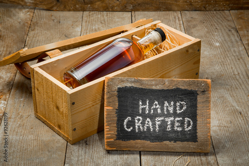 Fotografie, Obraz  Hand crafted whisky bourbon rum spirit bottle in wooden gift package box
