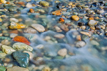 Pebble Stones In The River Water Close Up View,