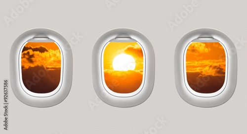 Fotografie, Tablou  Looking out the windows of a plane to the Black sea and sunset