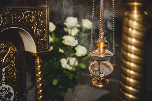 censer with smoke  in church Canvas-taulu