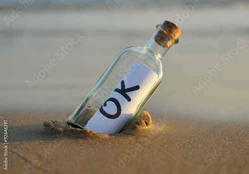 Bottle on the beach with ok Wallpaper Mural