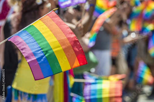Fotografía  GayPride spectators carrying Rainbow gay flags during Montreal Pride Parade