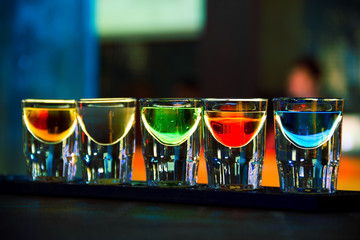 Fototapeta Koktajle Colorful shot drinks in nightclub