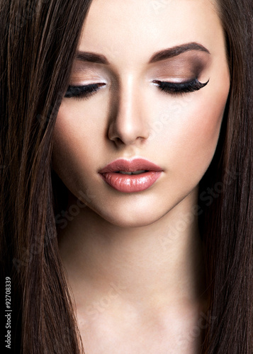 Poster  Face of beautiful young woman with brown make-up and  straight