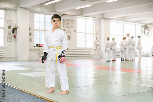 Foto op Plexiglas Vechtsport Boy been taken to a martial arts training