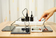 Man Is Turning Off  Power Adapters For Mobile Phones And Tablet