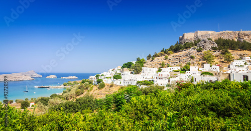 Panorama for Lindos village with castle ruins above