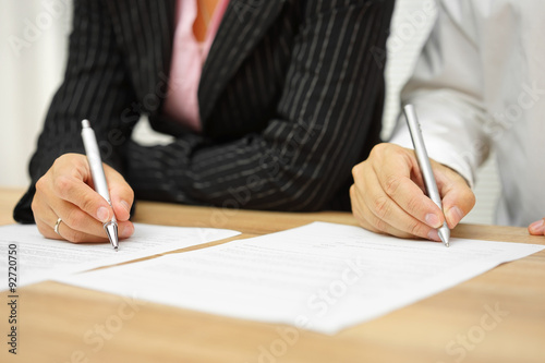 businesswoman and businessman signing contract in the office Canvas Print