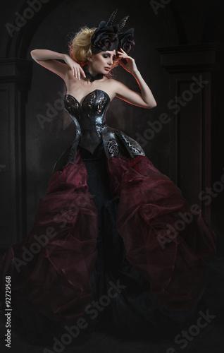 Poster Pleine lune Portrait of beautiful blond woman in dark sexy corset in studio