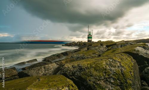 Obraz na plátne Ijmuiden Lighthouse at a stormy day