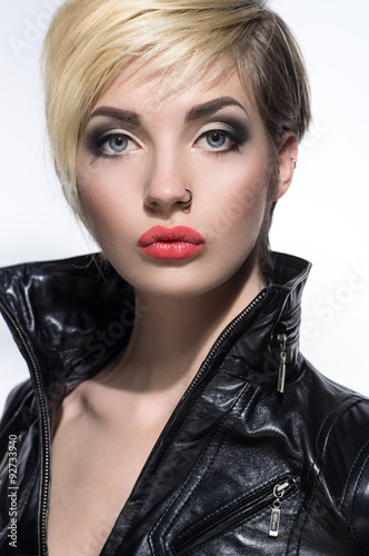 Beautiful portrait of woman with short hairstyle and piercing in nose