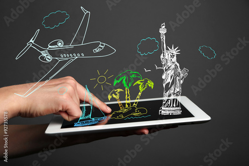 Fotografía  Concept of planning vacation - tablet  pc with vector illustrations
