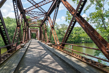 Pedestrian Rail Trail Crosses The Springtown Bridge Over The Wallkill River In Upstate NY Near New Paltz On A Bright Summer Day.