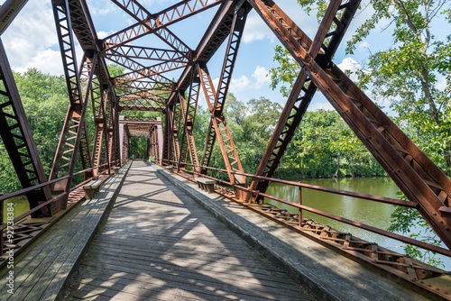 Fotografie, Tablou  Pedestrian Rail Trail crosses the Springtown Bridge over the Wallkill River in Upstate NY Near New Paltz on a bright summer day