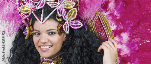 Montage in der Fensternische Karneval Beautiful samba dancer wearing pink costume and smiling letterbo