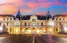 Louvre Museum In Paris At Sun...