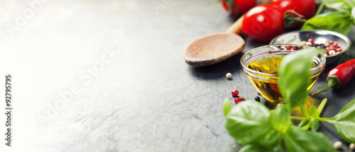 Poster Cooking Wooden spoon and ingredients on old background
