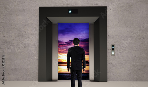 Fotobehang - Business man and elevator